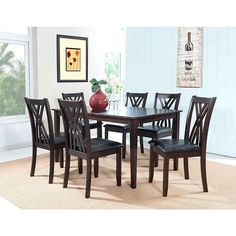 "Powell  Masten ""Espresso"" 7 Pc Table and Chairs. The Masten 7-piece dining set is the perfect family dining group. Satin semi-gloss espresso finish offers a striking modern profile with a combination of oversized block tapered legs and arced X-style chair backs. Black faux leather seat blends seamlessly into the contemporary setting. Some assembly required. *  oversized block  *   tapered legs  *  Satin semi gloss espresso finish  * arced X style *  Some assembly required.   *  Satin semi..."