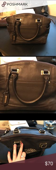 "Tignanello Brown Satchel Dark chocolate brown leather Tignanello satchel style purse with gold hardware. No visible signs of wear, however does not keep shape when stored. No dirt or scratches on bottom, or anywhere on bag. 3 outside pockets, 2 inside ""cellphone"" pockets and zipper pocket. Tignanello Bags Satchels"