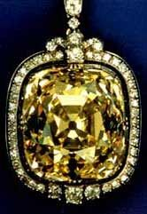 This amber-colored, cushion-shaped diamond weighing 102.48 carats, was formerly part of the Russian Crown Jewels.