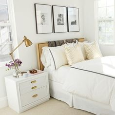 A grown up bedroom with luxe white bedding and brass accents.