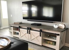 wooden TV stand or media center table with barn doors- Farmhouse style Custom Woodwork Custom Furniture - Molly's Marketplace - March 09 2019 at Farmhouse Tv Stand, Farmhouse Style, White Farmhouse, Farmhouse Door, Tv Stand Plans, Barn Door Tv Stand, Tv Stand Designs, Wooden Tv Stands, Diy Tv Stand