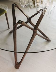 Round dining table with base in solid canaletta walnut and top in tempered glass (thickness mm. Glass Top Dining Table, Wooden Dining Tables, Round Dining Table, Dining Room Inspiration, Furniture Inspiration, Contemporary Dining Room Furniture, Furniture Design, E Piano, Shaker Furniture