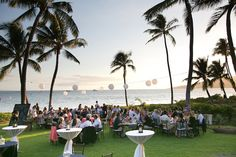 Make the most of your Maui destination wedding by having dinner outdoors next to the ocean and palm trees at Sugar Beach Events. | photo: Ken Kato