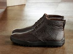 Refined casualness: Tod's Winter Gommino ankle boots in buffalo leather, with solid gommino soles and iconic details on heels. #tods #shoes #winter #todsgommino #ankleboots #fw1516 #fallwinter1516 #menswear #madeinitaly