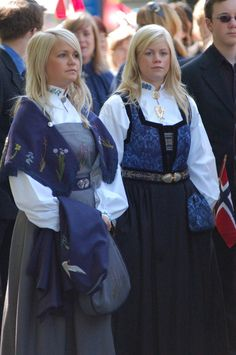 Bunad from the coastal region of northern Norway (left) and a generic festival bunad (right).