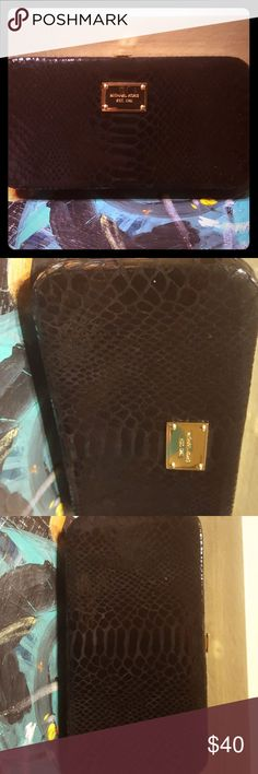Michael Kors black reptile clutch wallet Black reptile with gold hardwear. The inside has not been used. Exterior in great condition. Michael Kors Bags Wallets