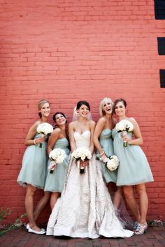 Love the colour of these bridesmaids dresses, great contrast with the wall too.  #wedding #weddings #bridesmaid #bridesmaids #blue #dress #dresses