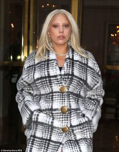 Parisian chic: The 28-year-old singer opted for a conservative look with aglamorous plaid...