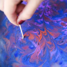 Learn to marble paper easily with acrylic paint, corn starch and water!