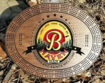 Personalized Engraved Hand Painted  black walnut Cribbage Board. 12 quality metal pegs. Storage for pegs in the back. Superior craftsmanship