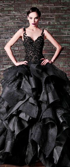 Rami Kadi: I just want to sit here and stare at how stunning this dress is! Look~ even the model feels it! You can tell by her fierce pose and look.
