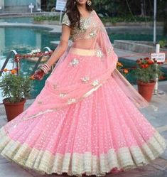 Pink Indian wedding sequins embroidered lengha with embellished blouse and embroidered dupatta. The lehenga choli is a custom made garment which include the blouse, lehenga(skirt) and a dupatta (stole). Skirt and stole material is net. It can be customised in any color of your choice. Blouse length Indian Bridesmaid Dresses, Indian Gowns Dresses, Indian Bridal Outfits, Indian Designer Outfits, Wedding Dresses, Half Saree Lehenga, Lehnga Dress, Lehenga Skirt, Heavy Lehenga