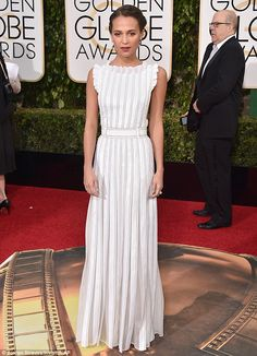 Winning look: Alicia Vikander was angelic in a delicate white Louis Vuitton dress as she arrived at the 2016 Golden Globe Awards