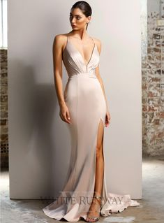 Georgia Gown. A sexy full length gown by Jadore. A deep v-neck style featuring a low back with criss-cross detailing and high leg split. #jadore #bridesmaid #weddinginspo #whiterunway