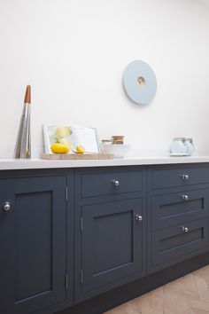 Deep blue in-frame Shaker kitchen. I like this but would want the colour to be slightly warmer