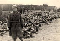Dachau death camp, Germany, 1945, American soldier photographed next to the bodies of inmates.