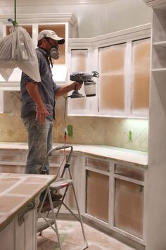 Kitchen Magician Painting cabinets to get that factory-finish lookPainting cabinets to get that factory-finish look Spray Paint Kitchen Cabinets, Kitchen Redo, Painting Cabinets, Kitchen Remodel, Wood Cabinets, Paint Inside Cabinets, How To Paint Kitchen Cabinets, Countertop Paint, Kitchen Ideas