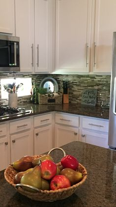 Updating: white kitchen cabinets, mosaic backsplash, tropical brown granite, stainless knobs  pulls, stainless appliances.