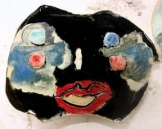 CERTAINLY SIR 9 W X 6 H FLAT CERAMIC MASK MADE FROM SCULPTED STONEWARE USING GLAZES, CHALKS AND PENCIL 2013Jennie Jieun Lee