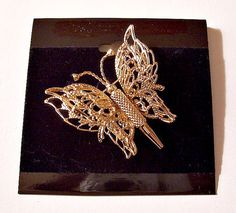 Monet butterfly pin brooch vintage double wing filigree gold tone metal finish openwork detail bug body antennas design. Measures 1 1/2