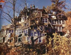 """Clarence Schmidt House  Clarence  Schmidt's """"House of Mirrors"""", was a strange  mansion with a """"labyrinth of passageways leading to spaces covered  in aluminum foil, paint, flowers, wood and shards of mirrors."""" It burned  in the 70's, but the Woodstock house is featured in """"My  Mirrored Hope,"""" Beryl Sokoloff's short film."""