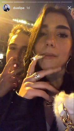 Dua Lipa smoking