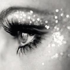 light; sparkle- the way the lighting hits the glitter in her makeup creates sparkle.