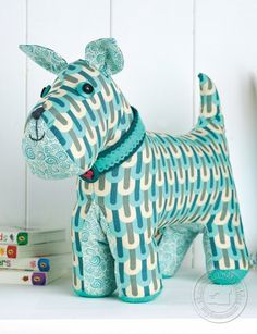 Выкройка собачки.<br>Источник: http://www.crafts-beautiful.com/free-downloads/stitched-dog-templates