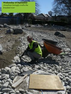 Jonathan Hall, Greening the Rubble site manager, crafts the edges of the braided river.