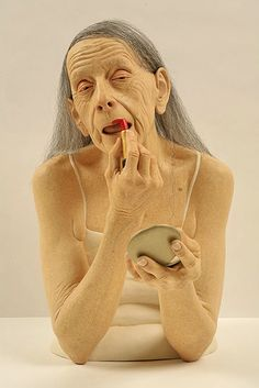 The characters in Tip Toland's hyper realistic sculptures are fragile creatures that find themselves at the end of adulthood or at the beginning of childhood.