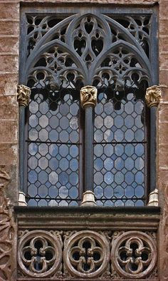 Beautiful Gothic black limestone window surround in Segovia.