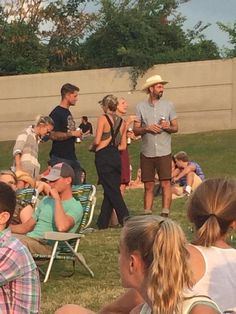 Shailene at a country concert that is her in the overalls and the really cute hat!