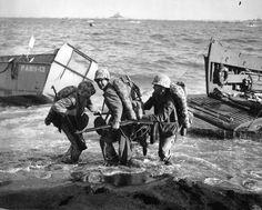 United States Marines haul an ammunition cart ashore. Iwo Jima, Japanese Volcano Islands. 19th of February 1945.