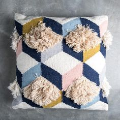 Our Brant Pillow is an eccentric pillow with pink, blue, mustard, and navy accents. Contrasting textures and bright color combine to make a bright pillow that