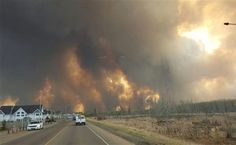 The entire population of the Canadian oil sands city of Fort McMurray, Alberta, has been ordered to evacuate as a wildfire whipped by winds engulfed homes and sent ash raining down on residents.