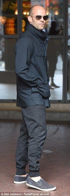 Sticking by her side: Rosie's handsome boyfriend Jason Statham, 48, cut a far more low-key...