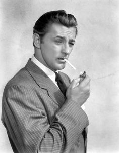"""""""An iconic figure of post-war Hollywood, Robert Mitchum embodied the rugged and and solitary anti-heroes of American film noir in a string of classic dramas and mysteries, including """"Pursued"""" Old Hollywood Glamour, Hollywood Actor, Golden Age Of Hollywood, Vintage Hollywood, Classic Hollywood, Old Hollywood Stars, Hollywood Hills, Classic Movie Stars, Classic Films"""