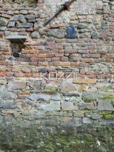 close-up of a brick wall. - Image of a weathered brick wall.
