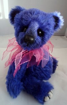 Please meet Amalite who is made from hand dyed deep purple schulte mohair, she is 9 inches tall and 5 way jointed. She has black glass english eyes and I have needle felted and sculpted her feet. Amalite is one of a kind bear and will arrive with her hand made clay love heart name tag with swing tag.  For more details , please email me at www.facebook.com/bearaliciousbears