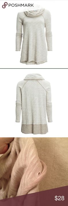 Free People Beach Cocoon Cowl Neck Sweater Free People Cocoon cowl neck oversized pullover in two color tones, cream and tan in S. Will fit a Medium as it runs bigger. Perfect to throw on and go! In excellent condition with one tiny hole pictured about a half an inch from end of cowl. Not at all seen or noticeable when worn. Priced according to condition.                      👍🏼 Smoke/Pet Free Free People Sweaters Cowl & Turtlenecks