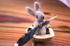 Submitted photoThis felted bunny rows his walnut shell boat with a blue jay feather.