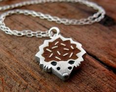 Hedgehog necklace.