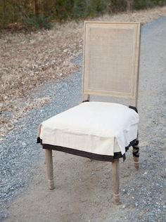 "Chairapron.com, Driftwood & Black Chair Seat Cover, Driftwood & Black Chair Seat Cover  Linen - built-in stain and spill repellant Fits chairs seats that measure up to 22"" x 22""   Price: $42.00"