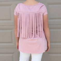 Blush Suede Fringe Tunic This faux suede short sleeve tunic shirt is not only cute, it is super comfortable. This darling shade of pink is looks perfect in fringe. Also available in an oatmeal color. Limited availability. These will go fast so snag yours quick! Entro Tops Tunics