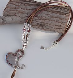 long leather necklace with heart