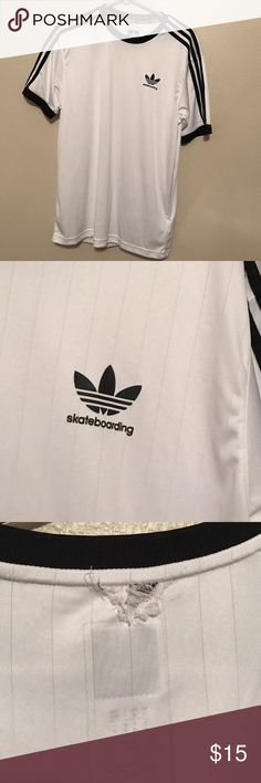 Adidas Skateboarding Jersey White Adidas Skateboarding Jersey with black details. Small Adidas logo on front left. Only defect is a small hole/snag on the bag by the collar. Got caught on a tree when I was skating and I sewed it back together to the best of my ability. Not really noticeable though Adidas Shirts Tees - Short Sleeve