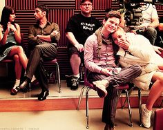 .Cute behind the scenes pic of Chris Colfer and Dianna Agron, with John Stamos and Lea Michele in the background!