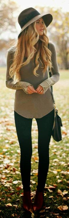 Try pairing an army green v-neck pullover with black leggings for a trendy and easy going look. A cool pair of burgundy leather booties is an easy way to upgrade your look.  Shop this look for $207:  http://lookastic.com/women/looks/hat-v-neck-sweater-crossbody-bag-leggings-ankle-boots/3956  — Brown Wool Hat  — Olive V-neck Sweater  — Black Leather Crossbody Bag  — Black Leggings  — Burgundy Leather Ankle Boots
