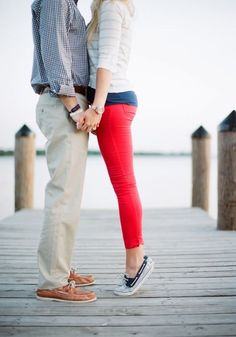 Cute engagement pose on dock
