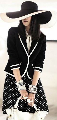Love the polka dot skirt with the blazer with a solid color top. No hat!